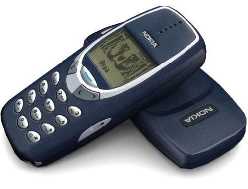 Nokia 3310 mobile phone with a navy faceplate