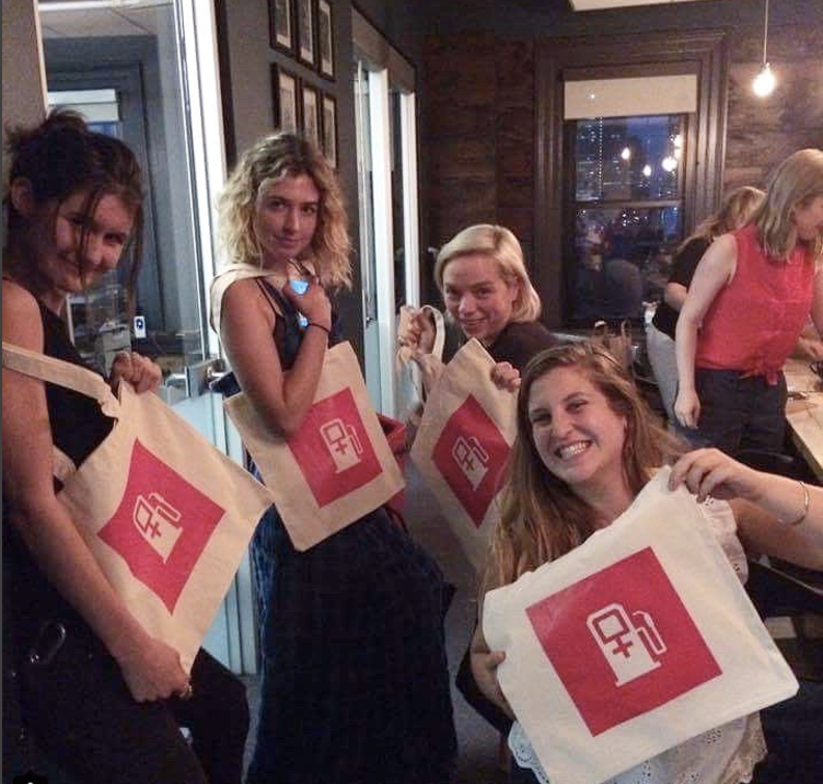 women of fueled hold up tote bags