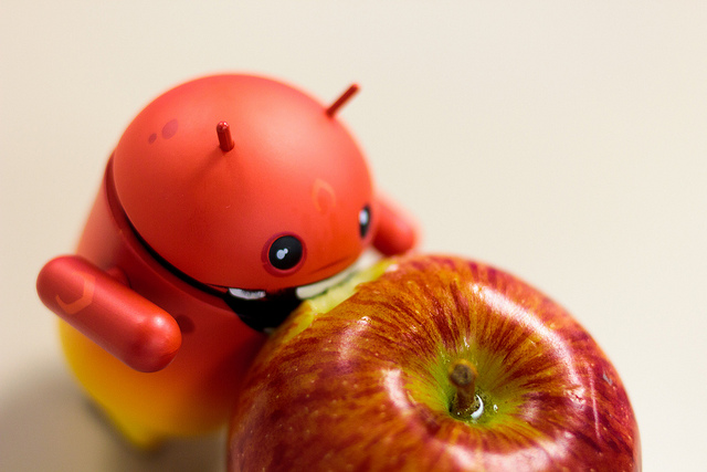 android eating apple image as a metaphor for the benefits of android app development