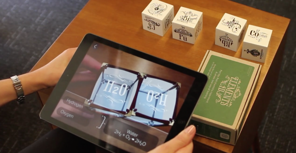 student with tablet interacts with AR chemistry cubes, ar, augmented reality, ar app, ipad, edtech, app developer, app development, ar app developer
